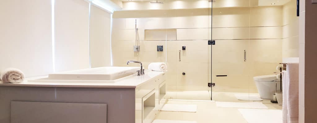 Shower glass hardware by Aldora, walk-in shower, soaker tub, ceramic tile, luxurious master bathroom, glass shower wall by Aldora