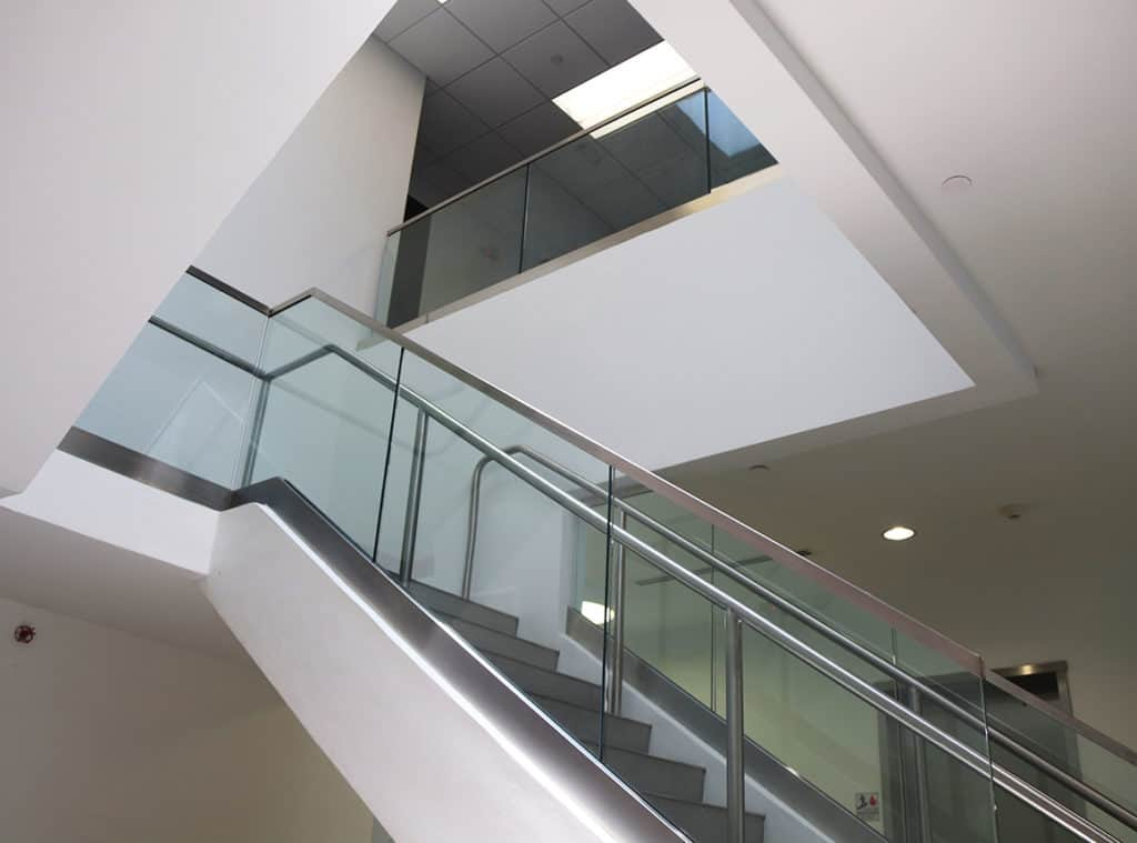 Upward view on laminated glass railing